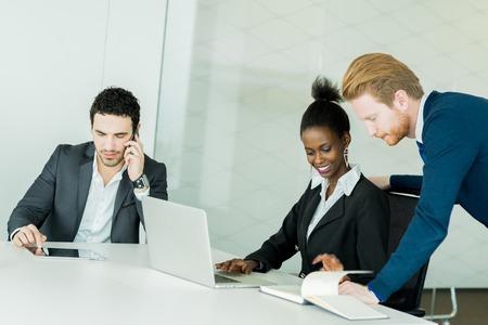 black business men: Business people discussing future plans and brainstorming at a white desk in an office