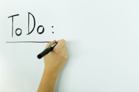 writing board: writing todo onto a white writing board
