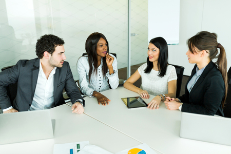 business results: Business talk while sitting at a table and analyzing  results Stock Photo