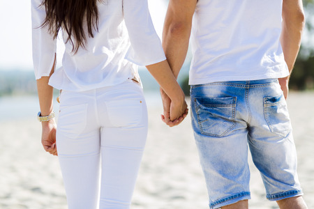romantic couple: Romantic couple holding hands on a beach Stock Photo