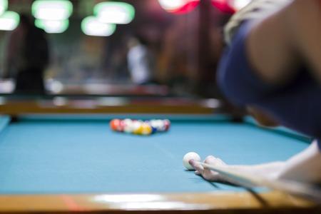 billard: Handsome man looking to break the balls in billiard Stock Photo