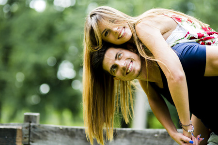 happy person: Happy couple in love having fun outdoors and smiling Stock Photo