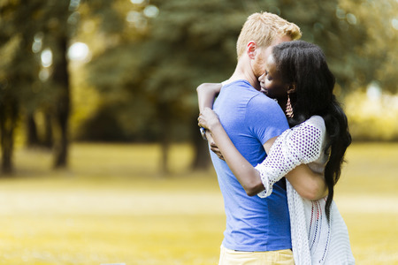 truly: Couple in love hugging peacefully outdoors and being truly happy
