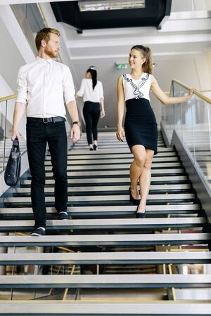 stairs: Group of businessman walking and taking stairs in an office building Stock Photo