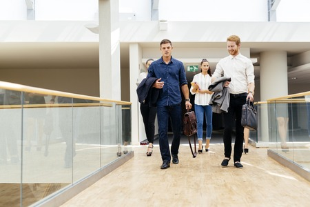 moving office: Business in motion, walking business people Stock Photo