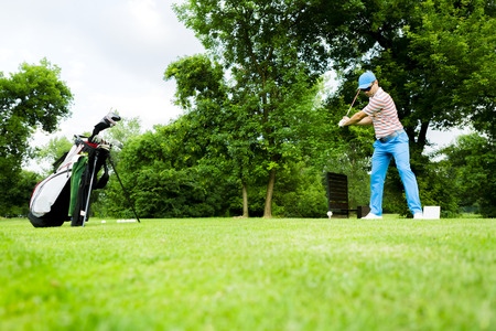 long shot: Golfer getting ready to hit the first long shot