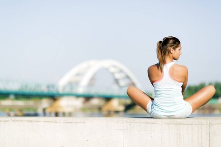 summer sport: Young woman stretching and relaxing in the city before exercise Stock Photo