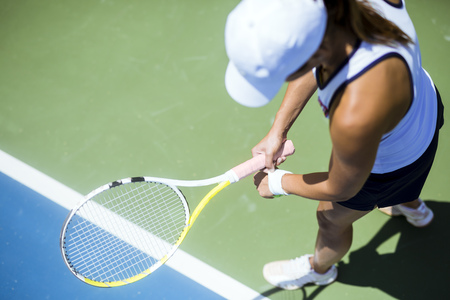 game to play: Beautiful female tennis player serving outdoor and a closeup of the serve from above