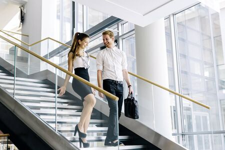 woman stairs: Business colleagues talking on stairs and flirting
