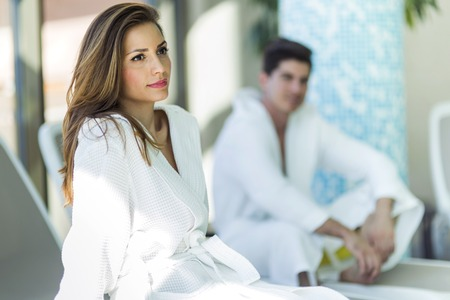 Portrait of a beautiful young woman in a bathrobe next to a swimming pool Stok Fotoğraf - 44909409