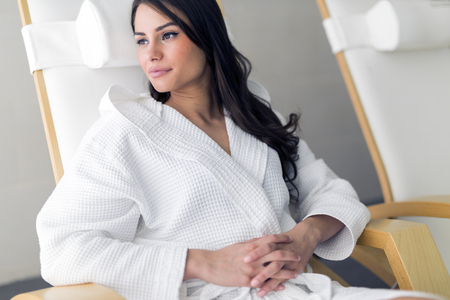 bath robes: Portrait of a beautiful young  healthy woman relaxing in a robe Stock Photo