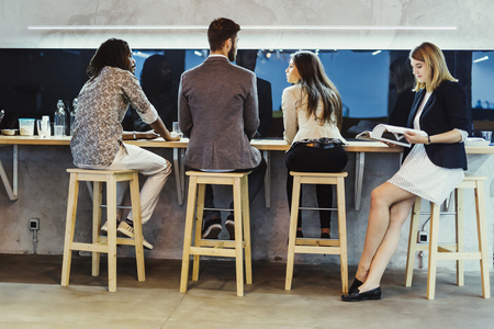 conversing: Business people having a break from work and conversing
