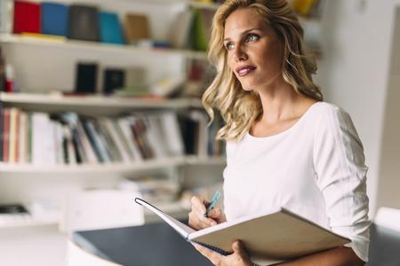 adult education: Stunning blonde woman reading