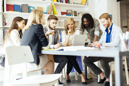 teamwork: Group of designers discussing trends and future projects Stock Photo
