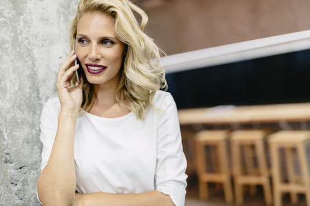 woman on phone: Beautiful woman talking on cell phone