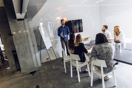 Group of coworkers at an office brainstorming and presentation