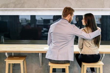 femme romantique: Handsome man hugging a beautiful woman in a bar