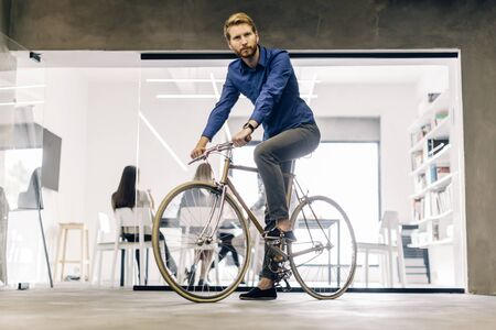 building work: Businessman riding a bicycle to work