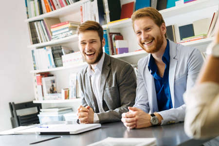 sincerely: Business smiling and laughing sincerely Stock Photo