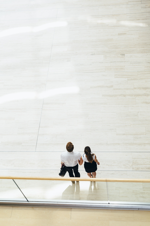 2 people: Business couple walking together. Top view
