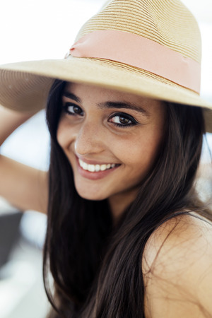 truly: Woman in hat smiling and being truly happy Stock Photo