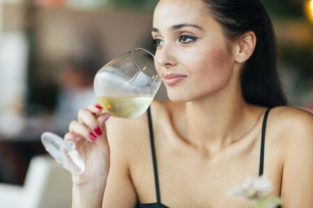 degustation: Attractive woman smelling the wine before degustation