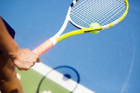 serv: Closeup of a player holding the racquet and preparing for the serv at the baseline Stock Photo