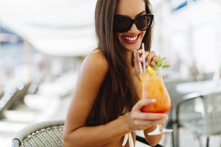 hot sexy girl: Sexy woman drinking cocktail in summer and enjoying her vacation Stock Photo