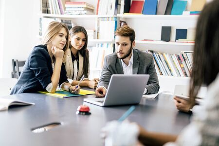 team cooperation: Business people working together in office Stock Photo