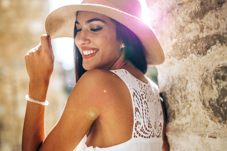truly: Beautiful sesnsual woman in hat being truly happy and positive