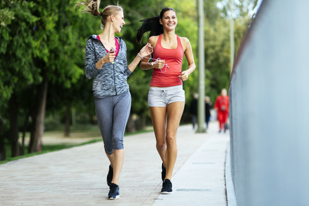 fit women: Fit women jogging outdoors and living a healthy lifestyle