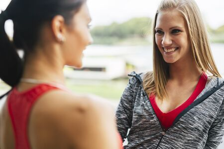 fit women: Fit women talking outdoors after jogging