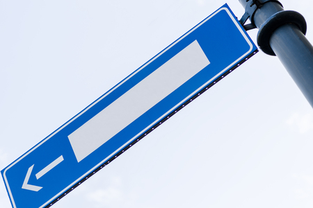 adboard: Empty blue road sign with direction arrow