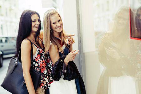 spree: Beautiful women shopping spree on street Stock Photo