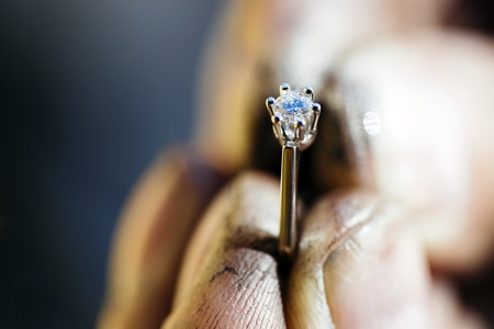 diamond rings: Ring held by jeweler after polishing it
