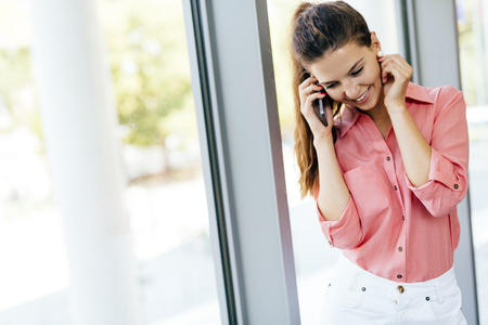 verry: Beautiful women using phone and being verry happy Stock Photo