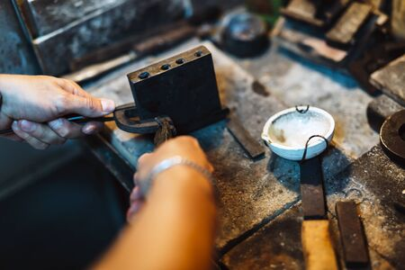 boron: Goldsmith crafting jewels the traditional way Stock Photo