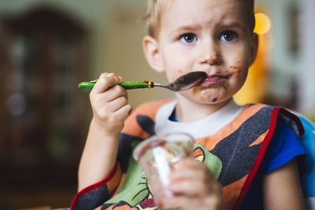 smeared: Smeared child eating Stock Photo