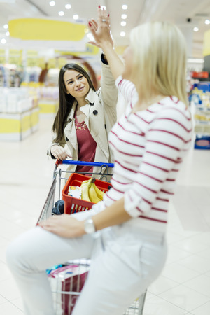 after shopping: Women satisfied after shopping in supermarket