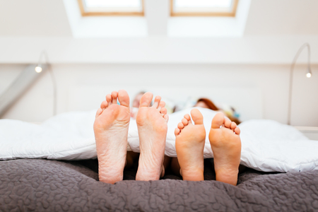 Couple resting in bed and taking a nap Stock Photo