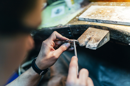 adequate: Jewelery polishing ring in workshop with adequate tools