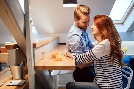 truly: Couple in love talking smiling at home while being truly happy