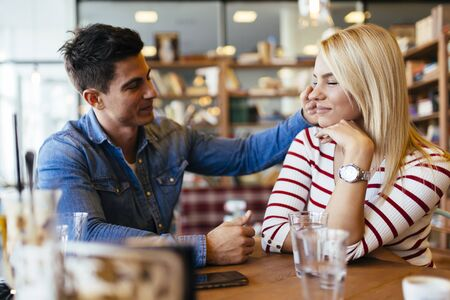 Beautiful couple in love flirting in restaurant and bonding Reklamní fotografie