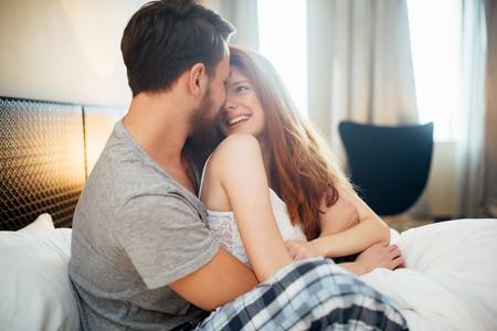 Sensual by couple in bedroom Banco de Imagens