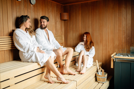 pursuing: People pursuing healthy lifestyles relaxing in sauna Stock Photo