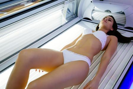 solarium: Beautiful sexy woman tanning in solarium Stock Photo