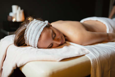 antiaging: Beautiful woman lying on massage table and resting