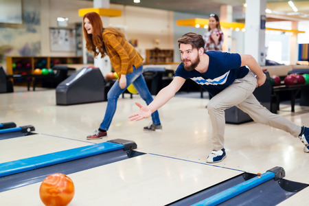 active adult community: Friends enjoying recreational bowling club at