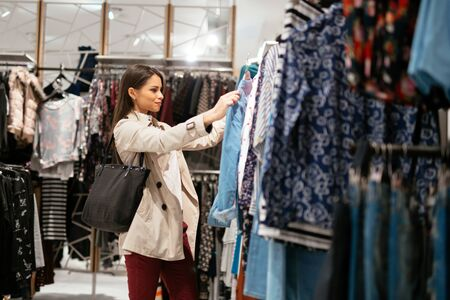 buying: Beautiful businesswoman buying clothes Stock Photo