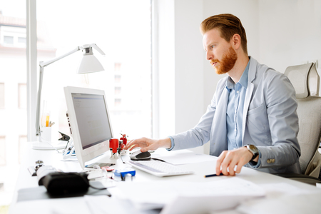Business person working on computer at his office desk